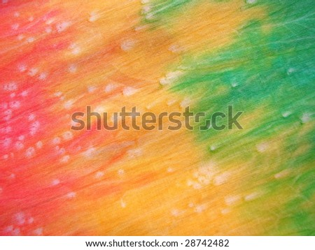 Tie-dyed Fabric in pink, yellow and green - stock photo