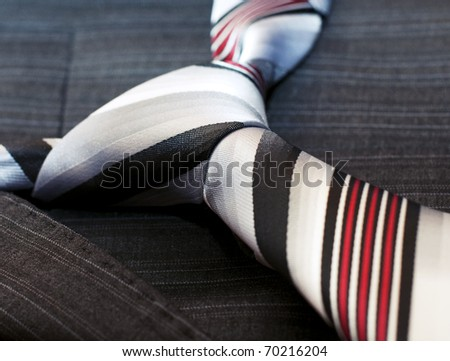 Tie lying on jacket. Closeup - stock photo