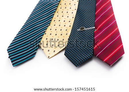 Tie, Tie-pin, Four ties of different colors. The blue tie with a tie pin. Shot on white background. - stock photo