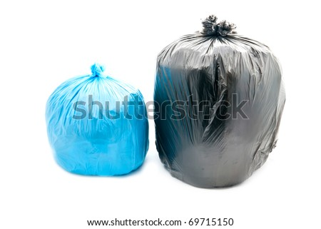 Tied black and blue garbage bags isolated on a white background. - stock photo