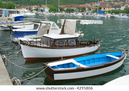 Tied boats in little marina of Tivat harbor