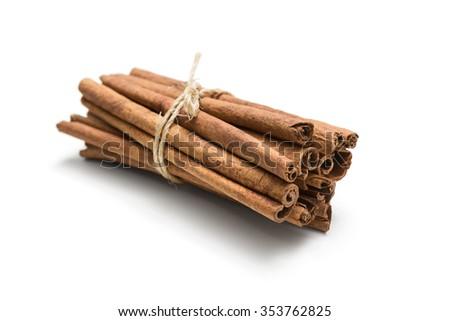 Tied cinnamon cassia sticks on white background  - stock photo