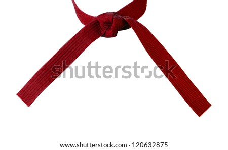 Tied Karate red belt closeup isolated on white background