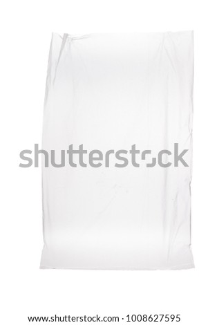 Tied plastic bag against  white background