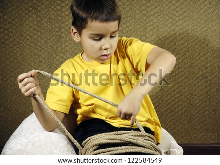 Tied up kid sit on a floor - stock photo