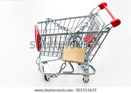 Tied up trolley with padlock. Conception of keeping shopping under control - stock photo