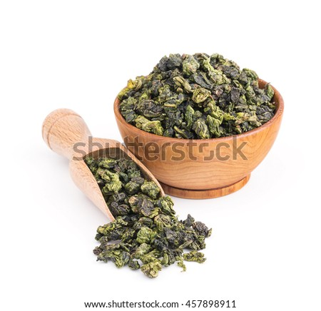 Tieguanyin oolong green tea in a wooden bowl isolated on white - stock photo