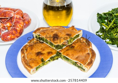 tiella vegetables and sausage - stock photo