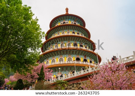 Tien-Yuan temple with cherry blossom in Taipei - stock photo