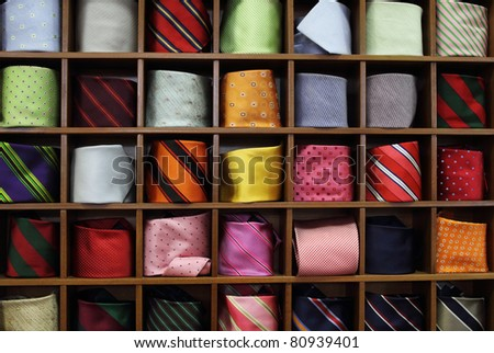 Ties on the shelf of a shop - stock photo