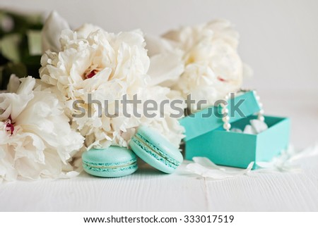 Tiffany blue macarons with peony and gift boxes  - stock photo