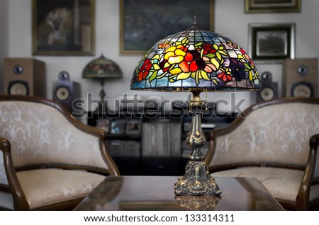 Tiffany lamp on wooden table - stock photo