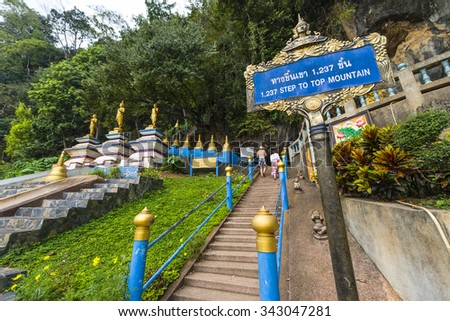Tiger Cave Temple in Thailand, Krabi, Phuket. A Buddhist temple sits high above the mountain, after a steep climb of 1237 stairs - stock photo