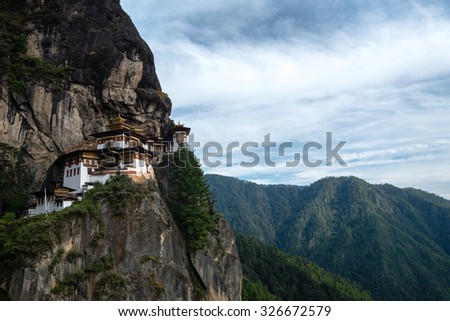 Tiger's nest monastery or Taktsang  Monastery  is a Buddhist temple complex which clings to a cliff, 3120 meters above the sea level on the side of the upper Paro valley, Bhutan. - stock photo