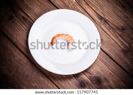 tiger shrimps on white plate - stock photo