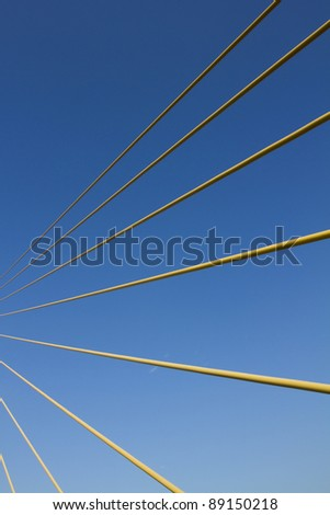 tight cables, tighting cables stretching the bridge on clear blue sky day. - stock photo