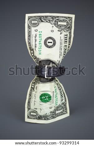 tighten belt on dollar concept - stock photo