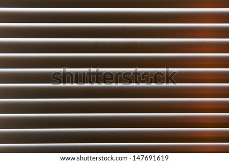 tightly closed from the glare blinds background - stock photo