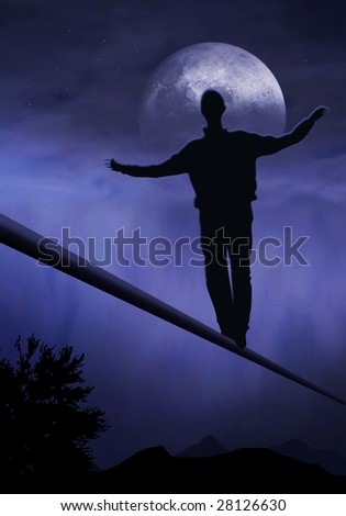 tightrope walker, artist is walking on a tighttrope - stock photo