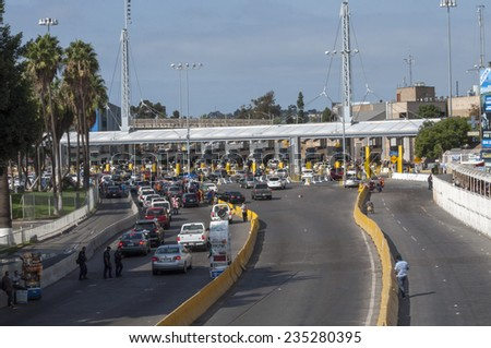 TIJUANA, MEXICO - NOVEMBER 13, 2014: The auto lanes at the Tijuana border crossing surprisingly have extremely short lines on this particular morning - stock photo
