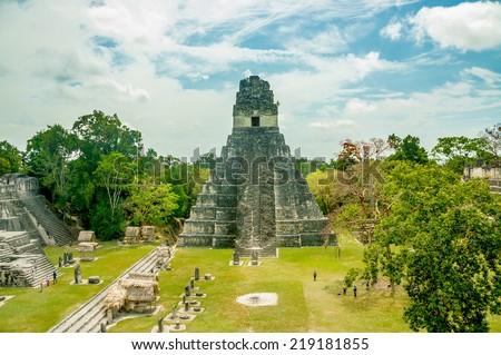 tikal mayan ruins of ancient city in guatemala rainforest - stock photo