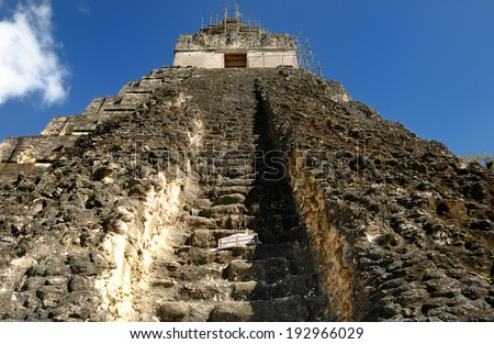Tikal pryramid mayan guatemala forest peten beautiful nature old travel history historic park stone religion national ruin civilization archeology native rain jungle travel oxygen - stock photo