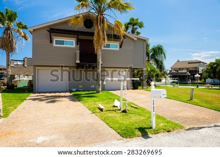 Tiki Island, Texas USA - May 6, 2014: The village of Tiki Island, located on a small peninsula in Jones Bay in Galveston County, is a popular coastal community containing beautiful waterfront homes. - stock photo