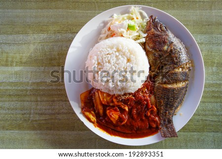 Tilapia fish, popular fish in Ghana, serve with steam rice in Ghanaian style