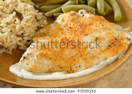 tilapia with parmesan sauce, rice and green beans