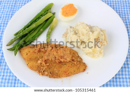 Tilapia with spicy Cajun seasoning deep-fried and served with fresh asparagus, deviled egg and potatoes mashed with sour cream and grated cheese.