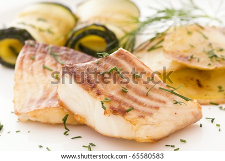 Tilapiini with Vegetable and Potatos - stock photo
