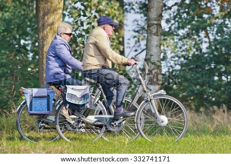 TILBURG-HOLLAND-OCT. 4, 2015. Senior on a Gazelle bike. Gazelle is the largest and most famous Dutch bicycle maker with 550 workers, producing 300,000 bicycles a year. Total number passed 13 million. - stock photo