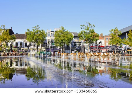 TILBURG-HOLLAND-OCTOBER 1, 2015. Hill Square, the central square of the city of Tilburg, located in the downtown area. The chain of cafes with seats outside is a popular place for social meetings.  - stock photo