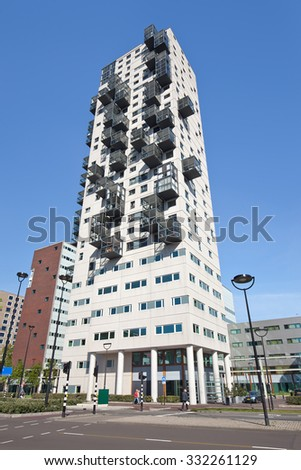 TILBURG-HOLLAND-SEPT. 29, 2015. Stadsheer (City Lord), 101 meter tall residential tower in Tilburg center. The building is the second highest of Tilburg. Characteristic of the tower are the balconies. - stock photo