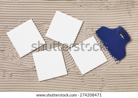 Tile Adhesive and tiles - stock photo