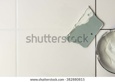 Tile and grout to the spatula - stock photo