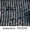 Tile lines in a rustic European roof - stock photo