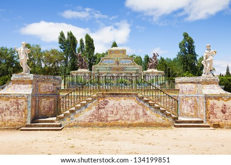 Tile mosaics and sculptures ornating along the canal of Queluz National Palace. Municipality of Sintra, Lisbon district, Portugal - stock photo