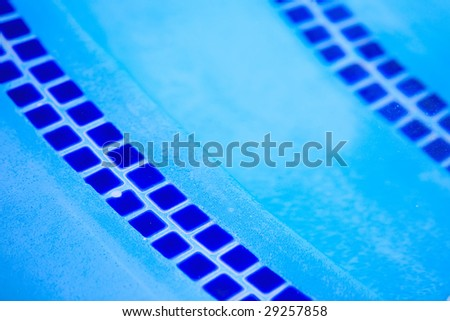 tile on steps of pool - stock photo