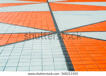 tile orange triangle pattern on Street - stock photo