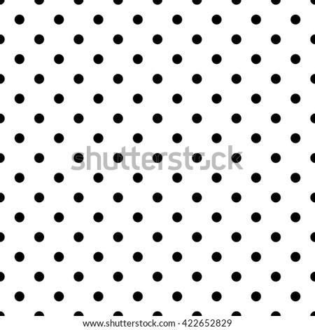 Tile pattern with black polka dots on white background