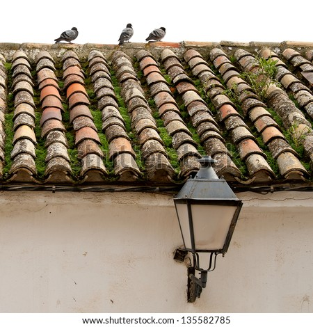 Tile roof of old house in Chinchon, Madrid, Spain - stock photo