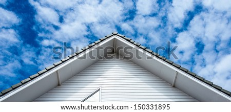 Tile roofing and shake gable details on modern home - stock photo