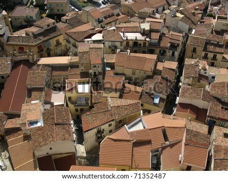 Tile roofs of Cefalu city, Italy - stock photo