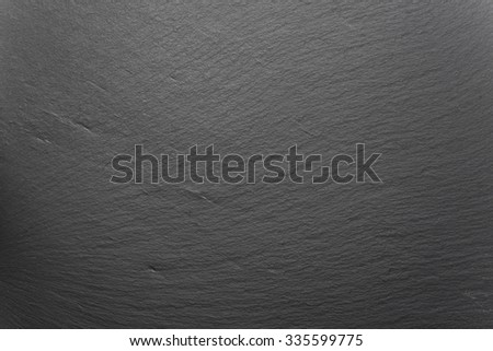 tile with shale texture forming black background - stock photo