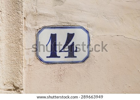 Tile with street number on exterior building wall, Florence, Italy - stock photo