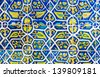 Tiled abstract background, beautiful blue and yellow decorated tile, vintage porcelain, ancient wall in the church, traditional Mexican floral pattern, art and architecture concept - stock photo
