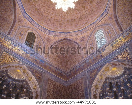 tiled and painted interior of a mosque - stock photo