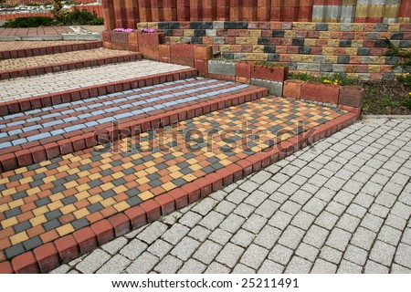 Tiled, colorful, decorative pavement. Sett blocks pattern. - stock photo