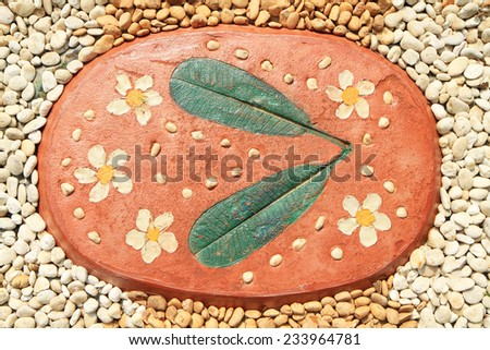 Tiled floor decorated with sand stone - stock photo